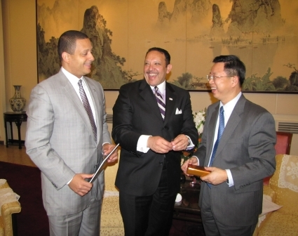 LA Urban League President and CEO Blair Taylor and National Urban League President and CEO Marc Morial share a laugh with Yu Ping, vice chairman of the China Council fort the Promotion of International Trade, after presenting him with gifts.