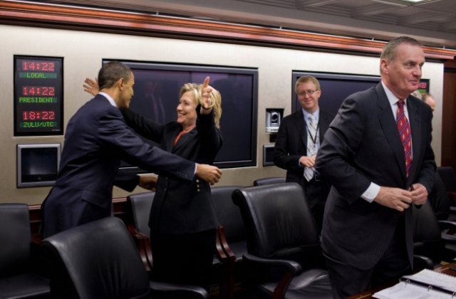 Secretary of State Hillary Clinton congratulates President Barack Obama on the House vote to pass healthcare reform, prior to a meeting in the Situation Room of the White House, March 22, 2010. (Source: White House)