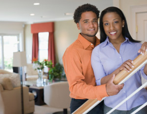 black couple in their home smiling