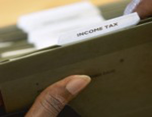 green folder labeled Income Tax