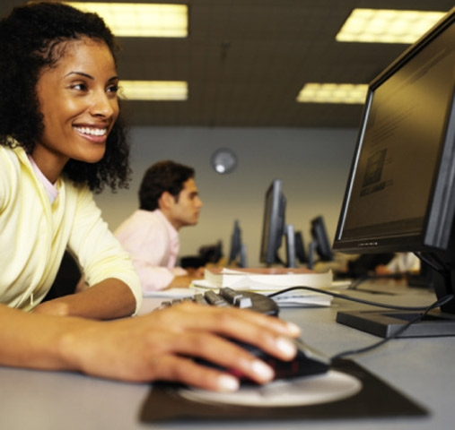 Woman on computer smiling