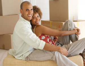 smiling-couple-moving-boxes