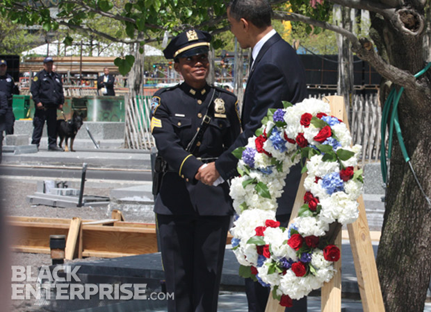 President Obama shaking hands with female officer at 9/11 memorial wreath ceremony