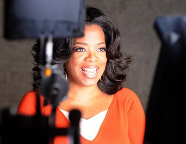 Oprah Winfrey behind studio cameras
