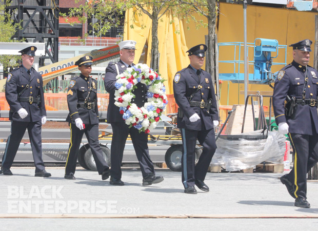 Officers carrying wreath to 9/11 memorial site