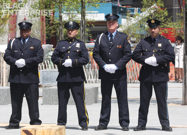 Servicemen at attention during 9/11 memorial wreath ceremony