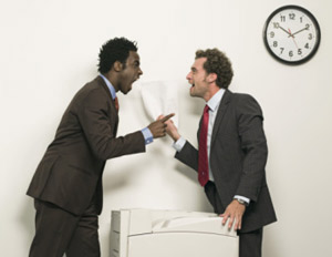 Two men arguing at work over the copier