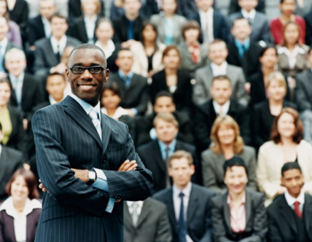 Businessman Standing in front of a crowd