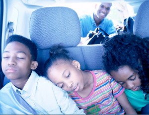 black family/sleeping children in a car