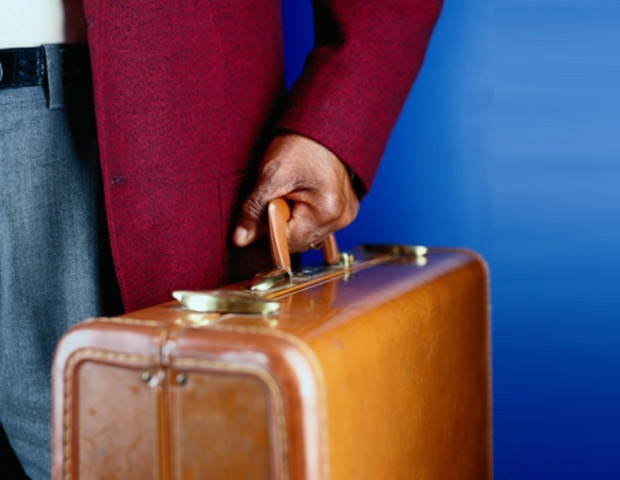 African American man's hand carrying luggage