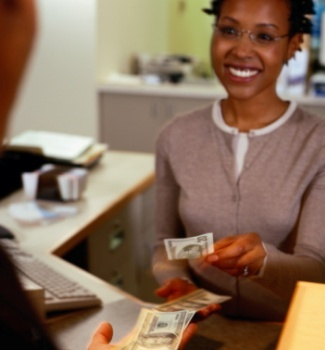 black woman at bank smiling