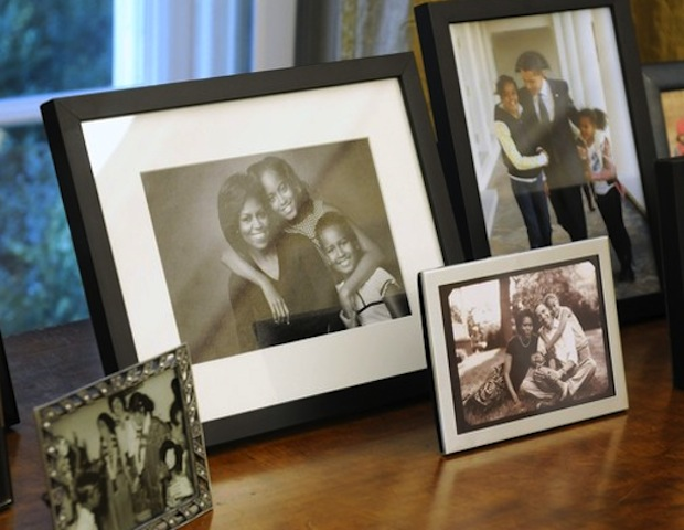 Close to the President's desk are photos of the First Family.
