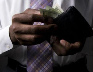 black man counting money from wallet