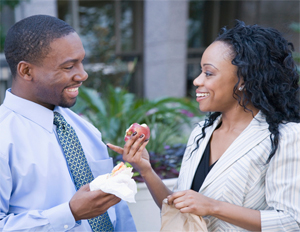 black man and woman talking and laughing