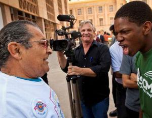 black kid screaming at old latino man