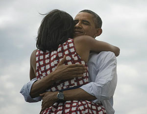 President Obama and wife Michelle Obama embrace