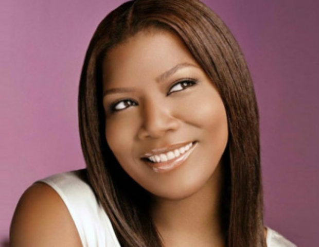 Queen Latifah smiling