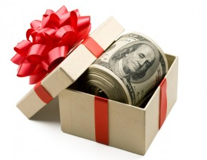 roll of money in a gift box with a red bow