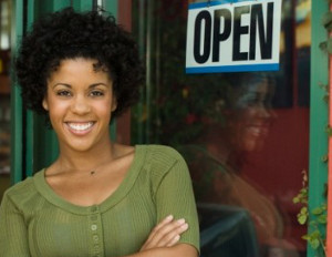 black woman who owns business smiling