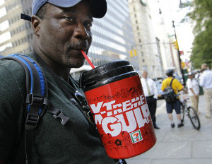 black man drinking big sugary drink