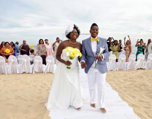 black gay couple married on beach