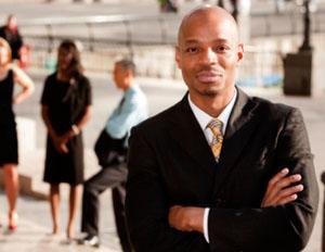 black man in suit smiling