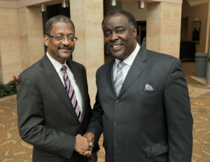 two black men in suits shaking hands