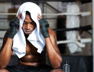 Black man thinking at the gym