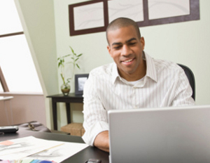 black guy at work on computer