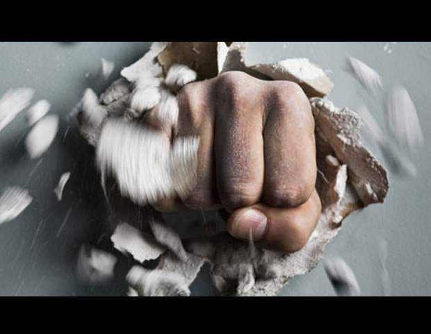a fist going through a wall