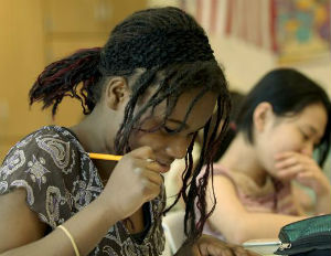 Black girl and Asian girl taking a test
