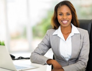Young black professional woman sitting at a desk