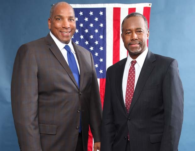Ben Carson and Butch in front of American flag