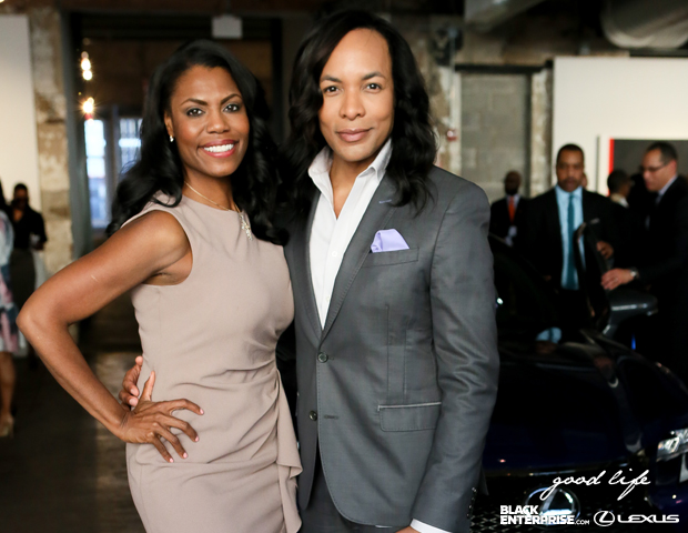 Omarosa and Paul Wharton pose for a picture.