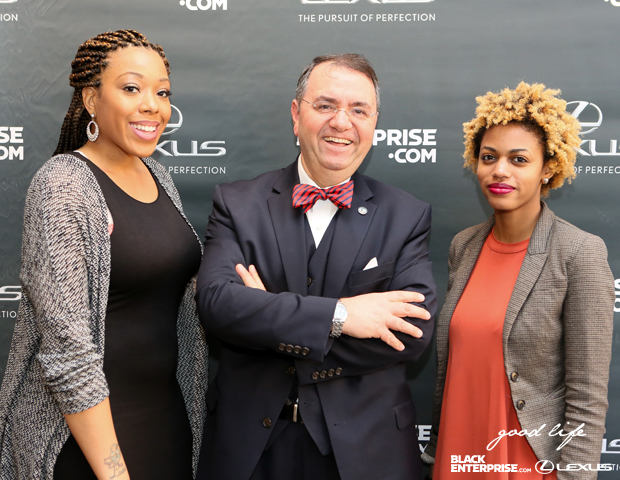 Makeup artist Khadijah Williams, VP and Business Development/Branch Manager for ColomboBank, Ali Kianersi, and Black Enterprise's Elisha Holmes pose for a picture on the red carpet.