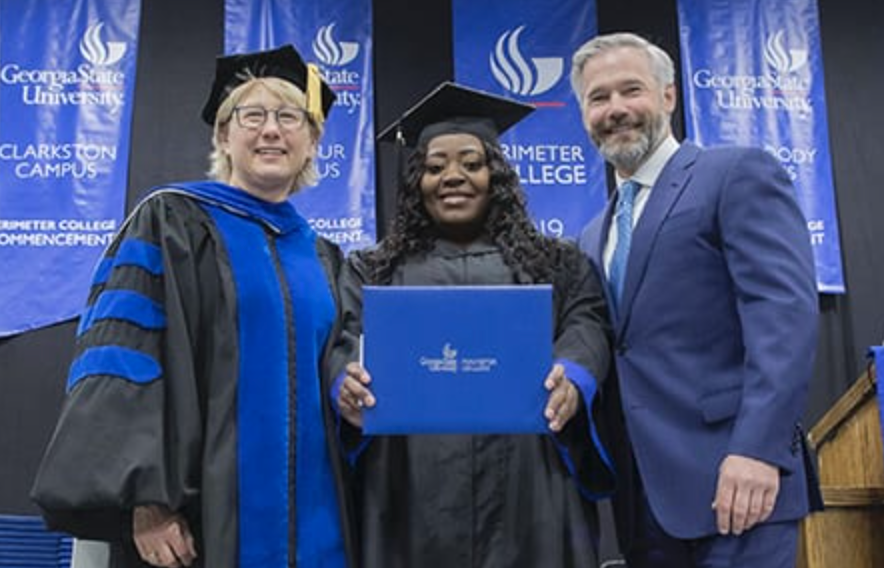 Latonya Young, center, shows off her degree alongside Georgia Perimeter College Dean Nancy P. Kropf, left, and Kevin Esch, the Uber passenger who paved the way for her to finish. (Photo by Bill Roa)